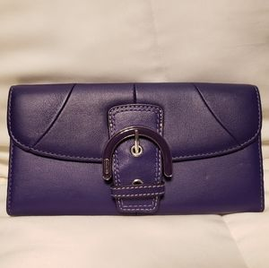Purple trifold coach wallet